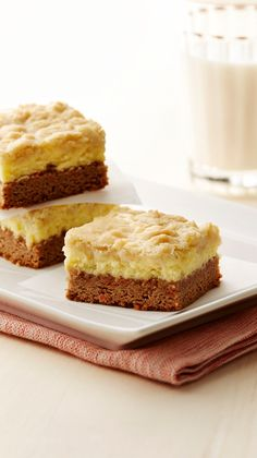 Carrot Cake Cookie Bars - This easy-yet-indulgent twist on carrot cake is a great make-ahead treat! This dessert tastes like carrot cake and cheesecake all in one.