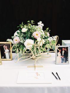 Laser cut guest book sign: http://www.stylemepretty.com/2015/11/03/elegant-blush-pink-duke-gardens-wedding/   Photography: Callie Davis - http://nancyrayphotography.com/