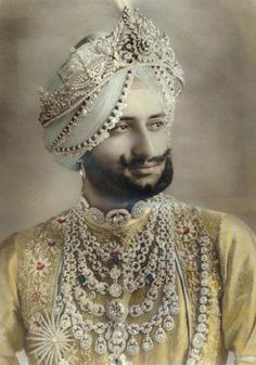 The Maharajah of Narawanger with his famed Cartier necklace.