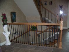 This staircase design was created using Twist series balusters. The long single twist (16.1.21) and the single basket double twist (16.1.3) pairs seamlessly to create a uniquely designed staircase. These components are available in Satin Black (shown) Silver Vein, Copper Vein, Oil Rubbed Bronze, Oil Rubbed Copper, Antique Nickel powder-coated finish. We offer parts, install services, and custom components throughout Texas. Click the image for more information.
