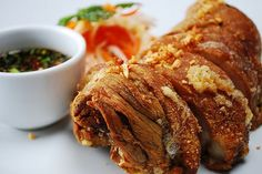Crispy Pata is a famous Filipino pork dish that uses a whole pig's leg. The leg (or pata) is made tender by simmering in water along with other spices. It is then rubbed with seasonings and deep-fr...