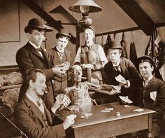Medical students pose with a cadaver around, 1890