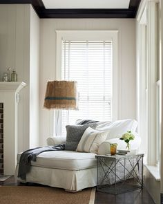 A crab trap side table and a lamp—both from a local boutique—bookend this sitting area's Shabby Chic chaise lounge. - HouseBeautiful.com