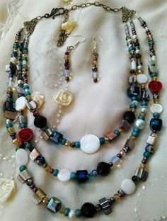Beautiful 3 strand necklace of Mother of Pearl, Swarovski Crystals, Seed Beads, Gemstones, Moonstone.  Stunning!