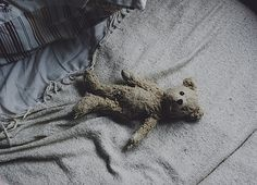 This is the tattered Bear of Childhood..the stuffed fur to bury my heartache to ..collector of my tears and witness to my smiles and Laughter..out of all friends and family my ruffled Bear knows me the most...Love him dearly.D.B.