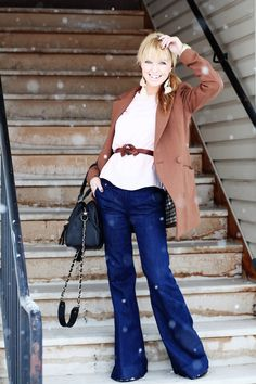 wide leg jeans with wedges are great! I also like the use of belts to accentuate the waist and a fun jacket!