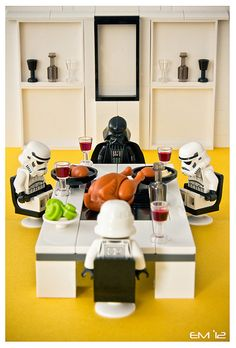 Darth Vader and Stormtroopers having saying grace before their Thanksgiving feast.