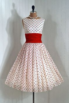 Party Dress: 1950's, flocked polka-dot chiffon, heavily-ruched cummerbund with sash, tulle-lined skirt, backside bow train detailing.