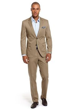 Professional, modern fit business suit in a lightweight stretch-cotton. A traditional two button jacket with notched lapels and back vents. Pair with matching flat front suit pants for timeless style. This high quality suit is distinguished by its natural lines and modern silhouette.
