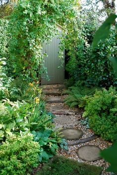 Interesting path using wood, pavers and pebbles...