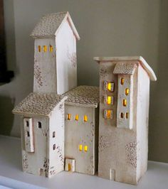 These Four Ceramic Houses are reminiscent of the house found in the hill towns of Tuscany Italy, I visited Sienna and San Gimignano and created these houses from my memory of my visit there. There are four houses they measure in height from 5 1/2 to 11 1/2 and are 2 3/4 wide and 2 3/4 deep except the smaller house which is 2 1/2 wide and 1 3/4 deep.    They were bisque fired then a stain was applied and then fired again. An acrylic matt sealer was applied. Three...