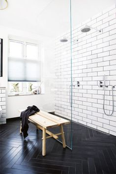 Herringbone tiles on floor / subway tiles on wall / double shower / floor to ceiling glass / wooden bench. Inside Out | Oct 2013