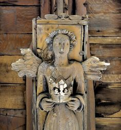 Methwold, Norfolk - St George: A C15th arch-braced and hammerbeam roof. Only five angels remain here, their wings reduced to stubs by decay or iconoclasm, but they are exquisitely carved, and perhaps the finest roof angel sculptures in Norfolk. Here a female angel bears a crown. She is reminiscent of a pair of crown-bearing female angels in St Mary's, Bury St Edmunds, which it has been suggested represent Margaret of Anjou, betrothed to Henry VI in 1444, and crowned as his queen in 1445…