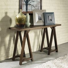 Give your living room, hallway or den more table space with this large sofa table. With a contemporary vintage style, this table combines an industrial vibe with retro design elements for a truly uniq