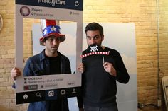 The Infatuation cofounders having fun with photo booth props