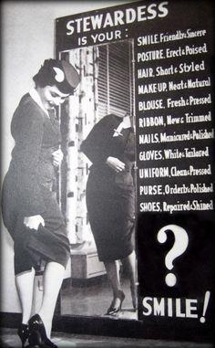 a Stewardess checks her appearance before flight