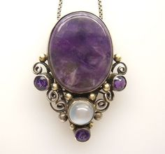 Dorrie Nossiter. Arts and Crafts dress clip. Silver, gold, amethyst and moonstone. Sold by artphilosophy on Ruby Lane, $1,195.00. View 3/9.