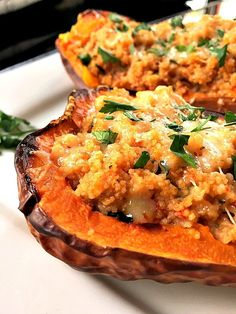 Roasted butternut squash stuffed with couscous and vegetables
