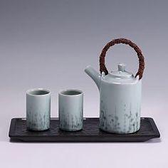 British potter, Chris Keenan, produces these elegant porcelain pots in a celadon glaze.