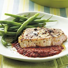 Seared Pork Chops with Spicy Roasted Pepper Sauce | MyRecipes.com #myplate #protein