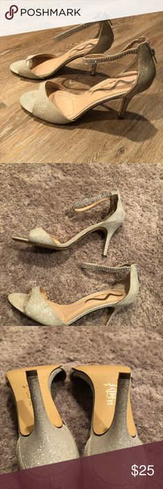 Mina ladies 3 1/2 inch sparkly heels Very sparkly glitter heels with rhinestone anklets. Zip up in back. My daughter wore these to the prom and never again. Decent condition. Some discoloration on toe area and needs zipper as you can see from the pictures . Nina Shoes Heels