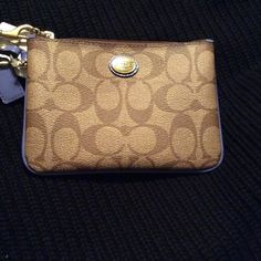 """Coach signature small wristlet Authentic Coach signature small wristlet. Khaki/Porcelain Blue. Code F50142. Dimensions are 6"""" length , 1/2"""" depth, 4.5"""" height. Cute as can be for spring. No box or bag but brand new with tags . No trades please and all offers must be done through the """" Offer """" option thanks ;) Coach Bags Clutches & Wristlets"""