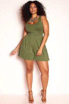 Cute and curvy in a short green summer dress. Plus size dresses.