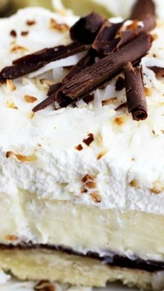 Chocolate Coconut Cream Pie Bars ~ This unforgettable dessert is layered with a shortbread crust, chocolate ganache layer, coconut cream, and topped with whipped cream! by corrine