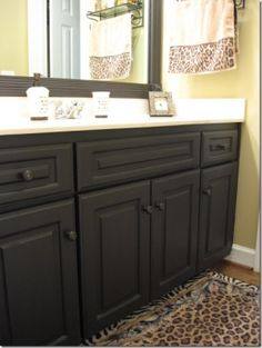 yes, you can paint laminate cabinets. Zinser BINZ and KILZ primer. @ Home DIY Remodeling Painting Laminate Cabinets, Painting Bathroom Cabinets, Bathroom Mirrors, Master Bathroom, Paint Bathroom, Bathroom Black, Diy Mirror, Bathroom Storage, Painted Furniture