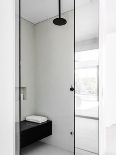 Minimal shower with black fixtures, by Lawless & Meyerson