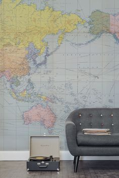 Love vintage interiors? This vintage map wallpaper showcases a beautiful array of pastel colours, marrying together old and new styles. In depth detailing of the world during the mid 20th century, including major shipping routes at the time. It's the perfect backdrop to sitting back, relaxing and listening to vinyl records.