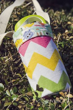 Waterbottle Carrier - references back to Pink Chalk design but includes template for bottom and reference to using PUL on inside fabric to capture condensation.