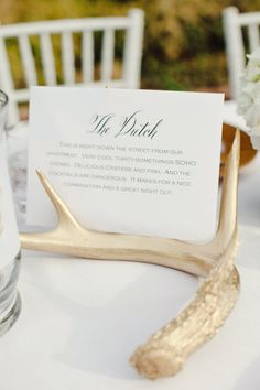 gilded antlers and tables named after the couple's favorite restaurants make for a super glam and oh so gorgeous tablescape  Photography by jnicholsphoto.com, Wedding Coordination and Design by mistyduncanevents.com