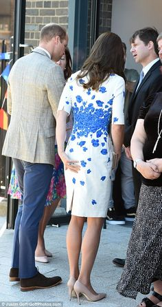 8/24/16*Kate smooths down her dress as she is greeted by Youthscape workers
