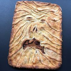 This pie will swallow your soul. Halloween apple slab pie with fright face crust