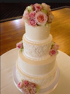 Buttercream Wedding Cake I created this based on one of our most popular designs requested from our clients, elegant scrolling and pearls-...