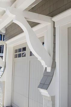 Painted brick and garage door corbels add rich details. l Beach Home Exteriors l www.DreamBuildersOBX.com