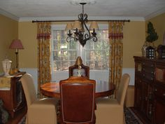 Colorful and Comfy Dining Room    think about this color with my   chairs