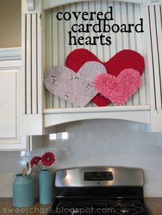 Cover cardboard hearts with different items (fabric, crepe paper, newspaper, etc).  Costs next to nothing!  #valentinesday -Done!