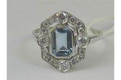 An Art Deco style 18ct white gold aquamarine and diamond ring. Large central octagonal aquamarine