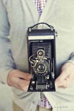 we should use antique cameras as part of the centerpieces
