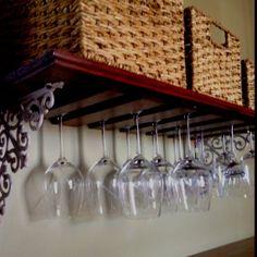 Homemade wine glass rack from leftover antique flooring.