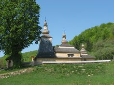 This wooden church is set in some of the most beautiful hilly countryside in eastern Slovakia. It sits on a slope above the village in fro. Statue Of Liberty, Countryside, Mud, Cave, Rock, Beautiful, Stone, House, Statue Of Liberty Facts