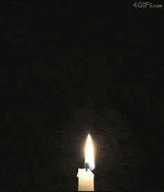 A candle lit by its vapor trail
