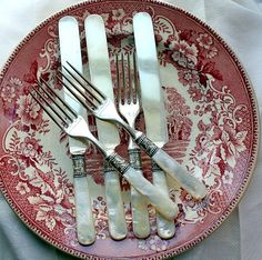 Set of Antique Victorian Mother of Pearl Flatware Service Sterling Ferrules... and love the dish too!