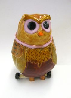 ceramic owls.  2 pinch pots on top of each other?  example is a HS student