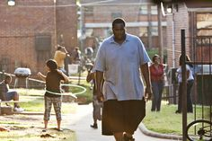 """""""The Blind Side"""" movie still, 2009. Quinton Aaron as Michael Oher. PLOT: A homeless and traumatized boy (Aaron) receives help from a woman (Sandra Bullock) and her family and transforms himself into an All American football player and first round NFL draft pick. Football Movies, Football Boys, Michael Oher, Delaware Blue Hens, The Blind Side, Movie Plot, American Football Players, First Round, Sandra Bullock"""