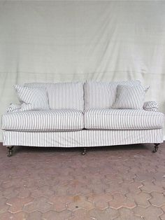"""the urban organic slipcovered sofa at 74"""" sports this season's hottest look, with a fully washable slipcover + hand turned legs. each cushion is made with a solid foam core wrapped in layers of down for the perfect combination of support + enveloping comfort. the low profile, english arms on this sofa are perfect for laying a pillow on + stretching out.   part of our exquisitely built collection of custom seating, this sofa is made in North Carolina + comes with a life-t…"""