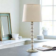 """Mercury Glass Stacked Ball Table Lamp, $139 Dimensions: Overall: 29 3/4""""H X 13"""" Diameter Base: 29 3/4""""H X 8"""" Diameter Shade: 11""""H X 13"""" Diameter w/11"""" Top Diameter Construction: Handmade of glass with brass socket holders and white linen shade. Lighting: Uses 3-way CFL or 100W max bulb. Cord is 8'L and clear. Country of Origin: India"""