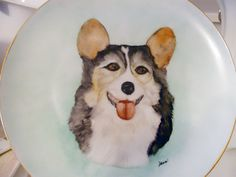 AUCTION to Benefit JCAPL, Animal Rescue  Plate is 8 inch round porcelain plate with 14 kt gold trim. Hand painted Pembroke Welsh Corgi, fired in artist's kiln..Serviceable..dishwasher safe, not recommend for microwave due to gold trim. Mary Dean, artist  Link to view all auction items and place a bid: https://www.facebook.com/media/set/?set=a.10152703514929549.1073741859.74160789548&type=1